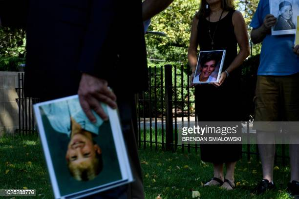 Activists speak during a press conference outside the Vatican's US embassy about sexual abuse in the Catholic Church on August 30 2018 in Washington...