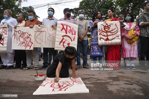 Activists stage a demonstration in Dhaka on October 19, 2021 to protest against the recent religious violence against the Hindu minority community in...