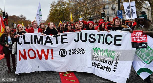 Activists stage a demonstration near the Arc de Triomphe at the Avenue de la Grande Armee boulevard in Paris on December 12 2015 A proposed 195nation...