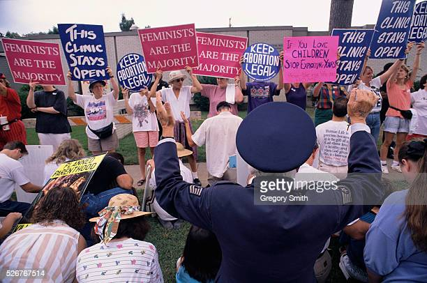Activists stage a demonstration outside of a pregnancy clinic in Little Rock Arkansas The prochoice demonstrators are met by antiabortion...