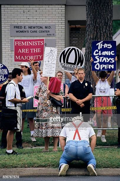 Activists stage a demonstration outside of the Women's Care Center in Little Rock Arkansas The prochoice demonstrators were met by antiabortion...