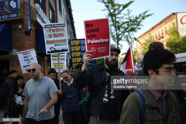 Activists stage a rally condemning the Israeli violence at the Gaza Strips eastern border on May 14 2018 in Bayridge neighborhood in Brooklyn borough...
