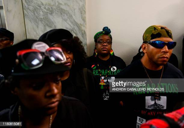 Activists stand in line waiting to enter a hearing about reparation for the descendants of slaves, before the House Judiciary Subcommittee on the...