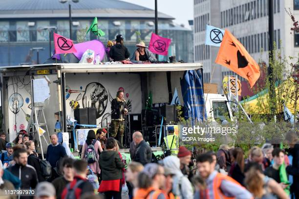 Activists stand on a lorry parked across Waterloo Bridge during the Extinction Rebellion Strike in London Environmental activists from the Extinction...