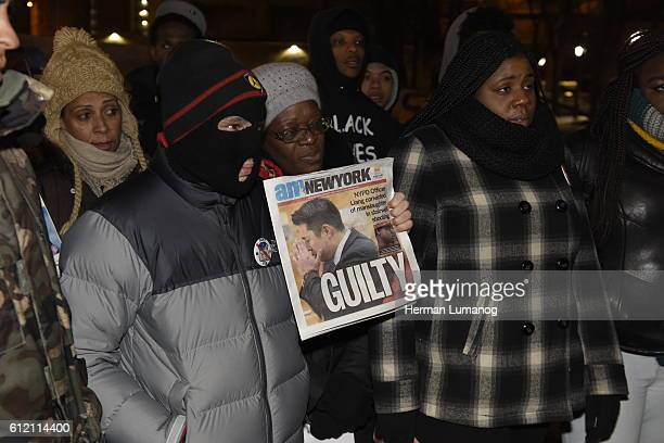 Activists stand with newspaper headline of Liang conviction Several dozen activists representing Black Lives Matter Picture The Homeless and NY...