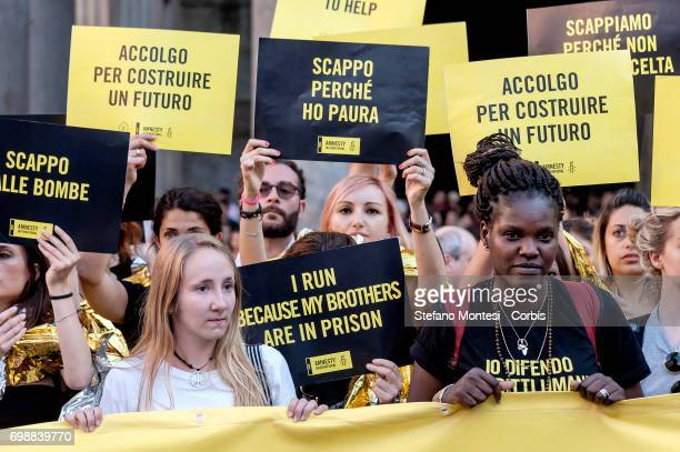 Activists supporting human rights organization Amnesty International protest in front of the Pantheon during a flashmob on World Refugee Day on June...