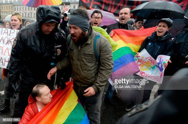 TOPSHOT LGBT activists take part in a May Day rally in Saint Petersburg on May 1 2018