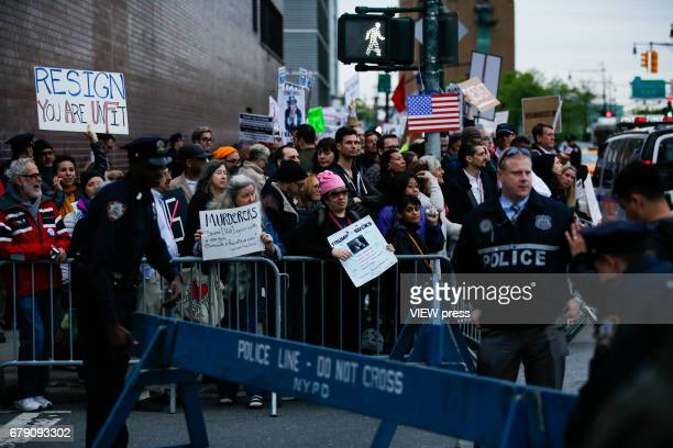 Activists take part in a protest near the USS Intrepid where US president Donald Trump is hosting the visit of Australian Prime Minister Malcolm...