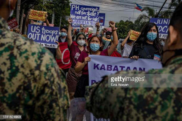 Activists take part in a protest versus the decades-old Visiting Forces Agreement and continued US military presence in the country, at the US...