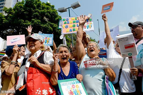 Activists take part in an antigovernment demonstration protesting for the shortage of medicaments in Caracas on March 31 2016 AFP PHOTO/FEDERICO...
