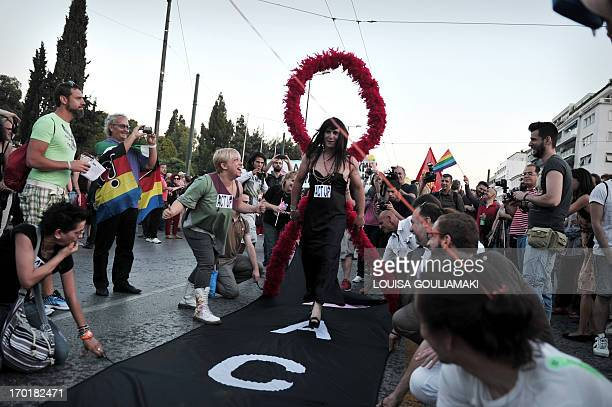 activists take part in the Athens gay pride parade on June 8 2013 Several thousand homosexuals leftist activists and antiracists marched in the...