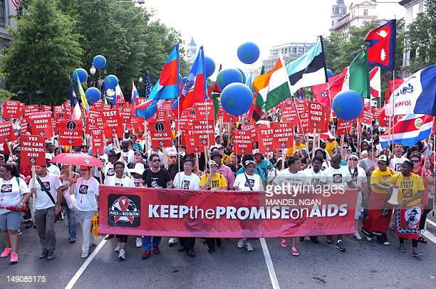 Activists take part in the Keep the Promise Alive 2012 AIDS march and rally on the streets of Washington on July 222012 Anthony Fauci director of the...
