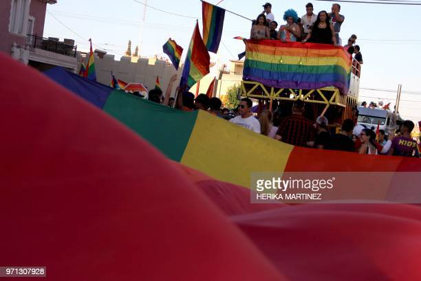 Activists take part in the Lesbian Gay Bisexual Transsexual and Transgender Pride parade in Ciudad Juarez Mexico on June 10 2018