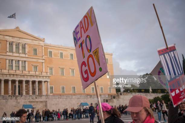 Activists take part in the Womens March 2018 in Athens demonstrating for women's rights LGBTQ rights equality in the workplace refugee rights climate...