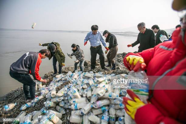 Activists throw PET bottles on an island near the DMZ on January 17 2018 in Incheon South Korea The human rights group organised by North Korean...