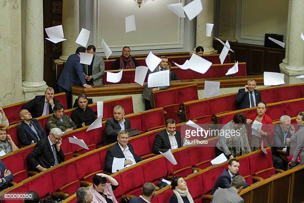 Activists throw the leaflets during the Verkhovna Rada session in Kyiv Nov 1 2016 Ukrainian lawmakers declared dozens of millions of dollars in cash...