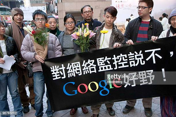 Activists unfurl a banner supporting Google Inc in a shopping district of Hong Kong China on Thursday Jan 14 2010 Google Inc's threat to pull out of...
