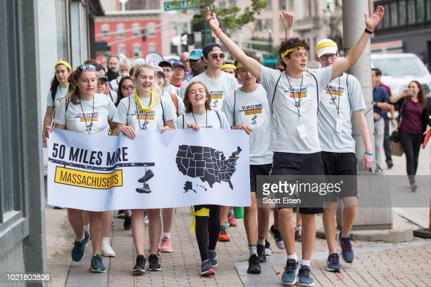 Activists walks during the 50 Miles More walk against gun violence which will end with a protest at the Smith and Wesson Firearms factory on August...