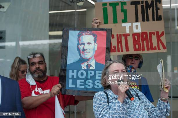 Activists wave banners and placards as dozens of supporters of Labour In Exile, Socialist Appeal and Labour against the Witch Hunt groups protest...