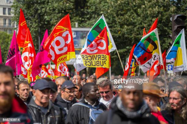 Activists wave banners and shout slogans as they take part in a demonstration in Paris during the nationwide protests called by several French unions...