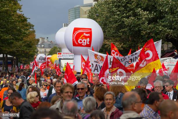 Activists wave banners and shout slogans as they take part in a demonstration during the nationwide protests called by several French unions against...