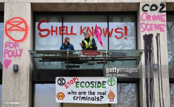 Activists wave flags from the porch covering the entrance to the Shell Centre, the UK offices of Royal Dutch Shell, on the second day of an...