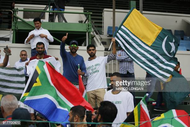 Activists wave the flag of Pakistanadministered Kashmir and wear tshirts bearing the message 'Indian army quit Kashmir' at the beginning of the fifth...