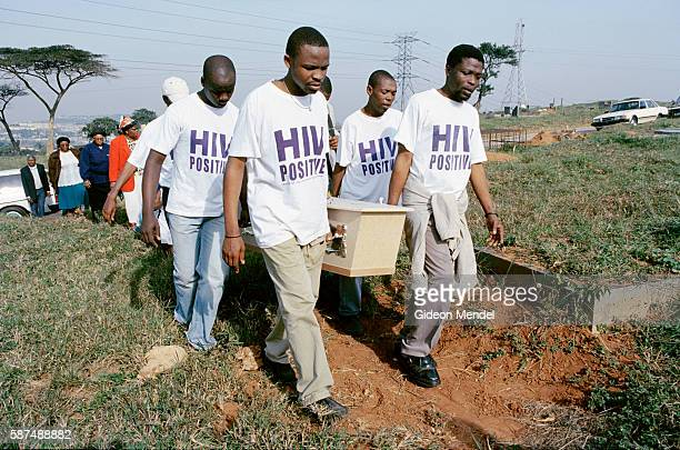 TAC activists wearing HIVpositive tshirts carry the coffin of TAC activist Ncane Surprise Xulu at the cemetery in Umlazi Township near Durban She...