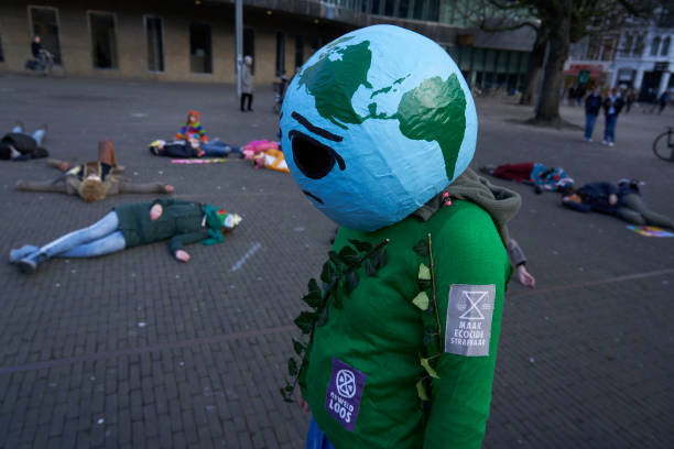 NLD: Climate Change Activists Perform A Die-In Protest