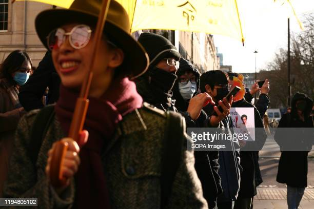 Activists wearing masks take part during the protest Activists rally in solidarity with the prodemocracy movement in Hong Kong and in protest at...