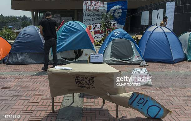 Activists who defined themselves as students from the College of Sciences and Humanities of the Autonomous University of Mexico camp outside the...