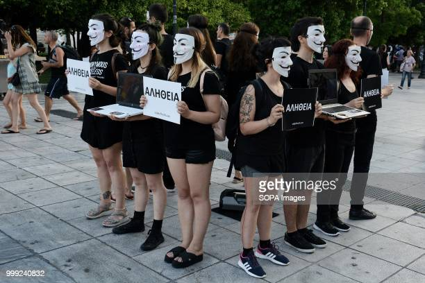 Activists with anonymous face masks during a demonstration by vegan activists for the 'voiceless' on Syntagma Square