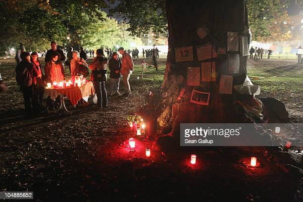 Activists with candles stand among some of the nearly 300 trees slated for removal in the Schlosspark next to Hauptbahnhof train station on October 6...