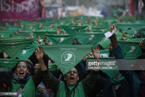 Activists with green handkerchiefs, which symbolizes the abortion rights movement, demonstrate to mark the revival of their campaign to legalize...