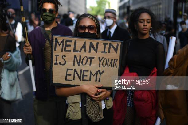 Activists with placards march during a Black Lives Matter protest against racism in central London on June 20, 2020. - British activists continue...