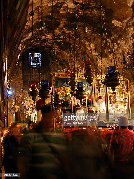 CONTENT] Activity inside the Tomb of the Virgin Mary in Gethsemane the garden at the foot of the Mount of Olives in Jerusalem Israel