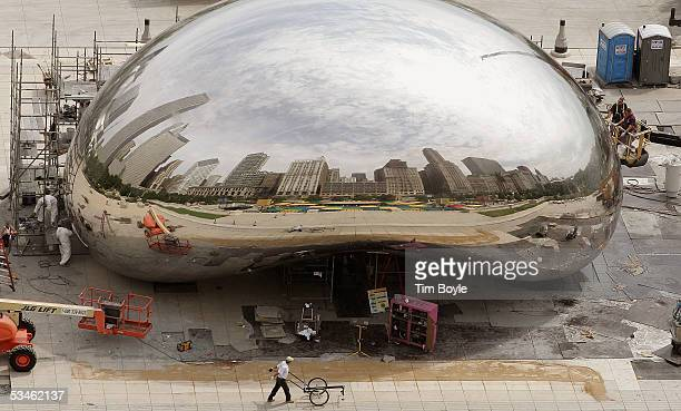 Activity is seen around the 110ton stainless steel Bean also called 'Cloud Gate' sculpture at Millennium Park August 25 2005 in downtown Chicago...