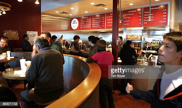 Activity is seen near the ordercounter area inside a Chipotle restaurant December 2 2005 in Glenview Illinois McDonald's Corp owners of 92 percent of...