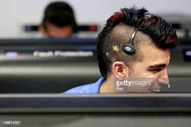 Activity lead Bobak Ferdowsi, works inside the Spaceflight Operations Facility for NASA's Mars Science Laboratory Curiosity rover at Jet Propulsion...