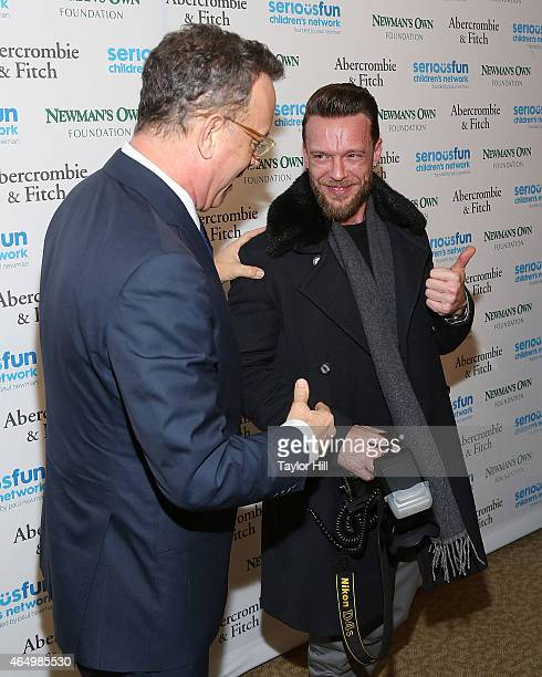 Acto Tom Hanks directs photographer Jamie McCarthy at the SeriousFun Children's Network's New York City Gala at Avery Fisher Hall on March 2 2015 in...