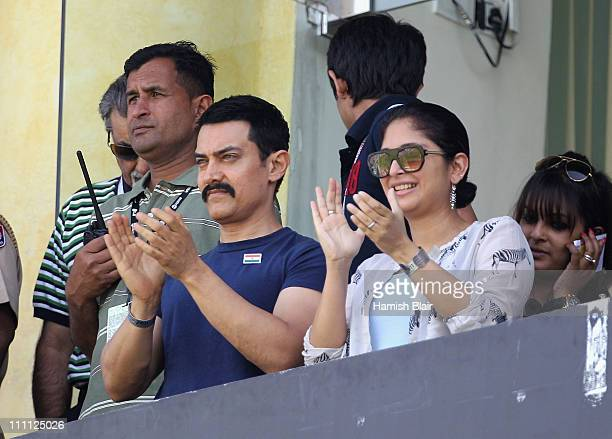 Actor Aamir Khan enjoys the atmosphere ahead of the 2011 ICC World Cup second SemiFinal between Pakistan and India at Punjab Cricket Association...