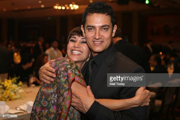 Actor Aamir Khan greets actress Koel Purie at the dinner party hosted after the India Today Conclave ended in New Delhi on March 13 2010