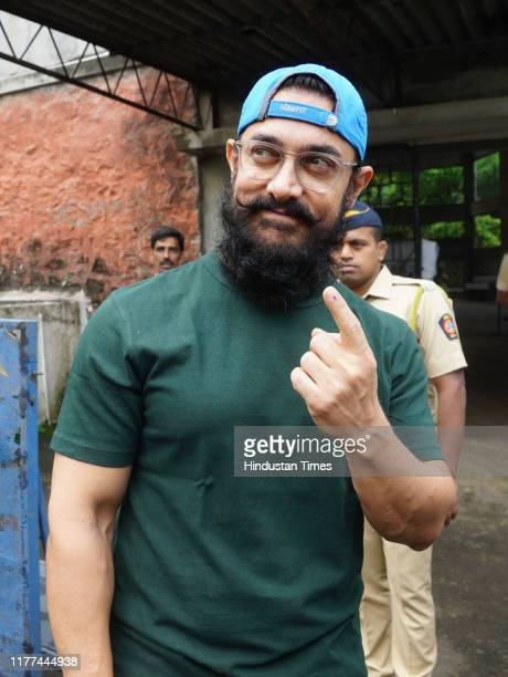 Actor Aamir Khan poses for cameramen after casting vote for Maharashtra State Assembly Elections at St. Annes school Bandra on October 21, 2019 in...