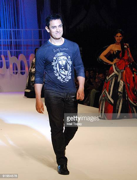 Actor Aamir Khan walks the runway in support of fellow actor Salman Khan's foundation 'Being Human' on the second day of the HDIL India Couture Week...