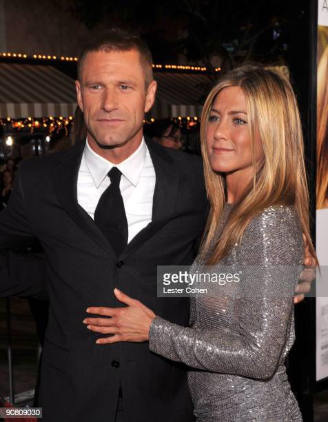 Actor Aaron Eckhart and actress Jennifer Anistonarrive on the red carpet at the Los Angeles premiere of Love Happens at the Mann's Village Theatre on...