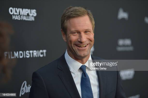 Actor Aaron Eckhart attends Brioni Sponsors Film District's World Premiere Of 'Olympus Has Fallen' ArcLight Cinemas on March 18 2013 in Hollywood...