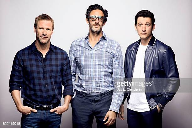 Actor Aaron Eckhart director Ben Younger and actor Miles Teller from the film Bleed For This pose for a portraits at the Toronto International Film...