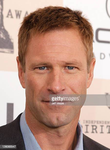 Actor Aaron Eckhart poses on the carpet with LG Cinema 3D HDTV during the 2011 Film Independent Spirit Awards at Santa Monica Beach on February 26...