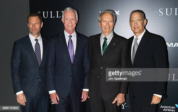 Actor Aaron Eckhart retired airline captain Chesley 'Sully' Sullenberger director Clint Eastwood and actor Tom Hanks attend the 'Sully' New York...