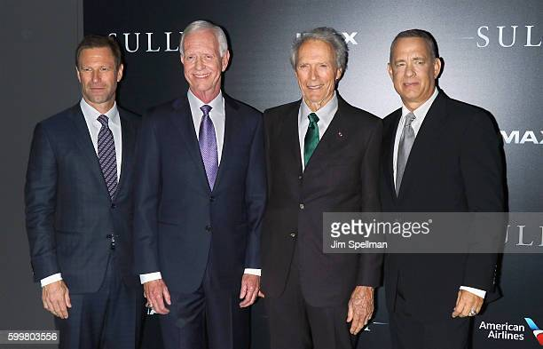 """Actor Aaron Eckhart, retired airline captain Chesley """"Sully"""" Sullenberger, director Clint Eastwood and actor Tom Hanks attend the """"Sully"""" New York..."""